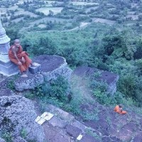 Cambodian monks sit at top of Phnom Chisor