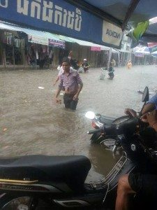 khmer guy walking through flood